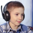 Child close up listening to music on headphones, smart attentive, happy baby, 1080p video — Stock Video #68158035
