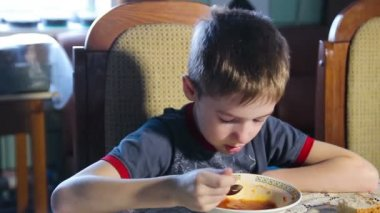 Offended little boy during a meal, soup for lunch 1080p HD — Stock Video