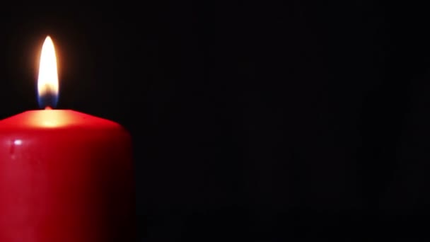 One candle burns brightly in the dark. HD 1080p video in motion — Vidéo
