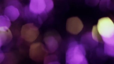 Background bright light yellow purple gray abstract background bokeh holiday ornaments bright spot defocused circle shiny Christmas decorations — Stock Video