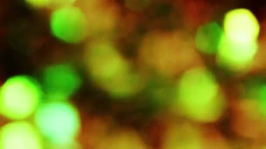 Background bright light green yellow orange red gray abstract background bokeh holiday ornaments bright spot defocused circle shiny Christmas decorations — Stock Video