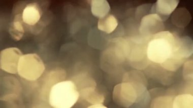Background shining light gold fire abstract bokeh background bokeh holiday ornaments bright spot defocused circle brilliant — Stock Video
