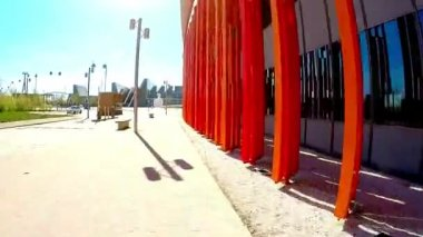 Movement along the bright colored walls of a modern building in sunny day — Stock video