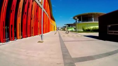 Movement along the bright colored walls of a modern building — Stockvideo