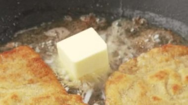 Breaded escalopes being fried in a pan — Stock Video
