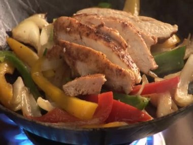 Cooking vegetables and chicken breast fillet — Stockvideo