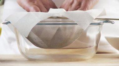 Broth being sieved through a sieve — Stock Video