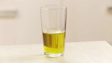 Glass of olive oil being taken — Stock Video