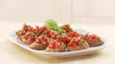 Bruschetta toasted bread topped with tomatoes — Stock Video