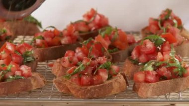 Bruschetta being sprinkled with pepper — Stock Video