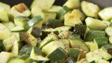 Fried and diced courgette — Stock Video