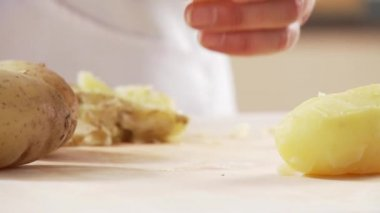 Potatoes being peeled — Stock Video