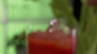 Tomato juice garnished with celery — Stock Video