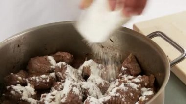 Goulash dusted with flour — Stock Video