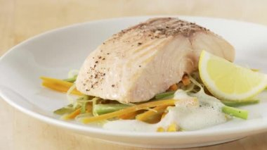 Steamed salmon being served with a sauce — Stok video