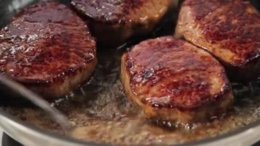 Steaks poured with butter — Stock Video