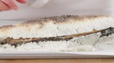 The salt crust being lifted off a salmon — Stock Video