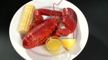 Cooked lobster with corn on the cob — Stock Video