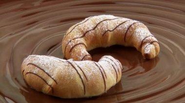 Nut croissants on chocolate — Stock Video