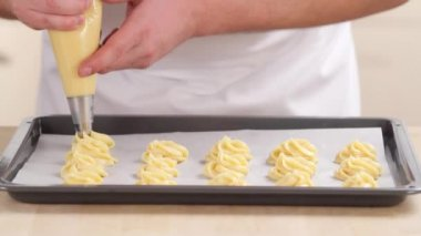 Choux pastry being piped onto a baking tray — Stock Video