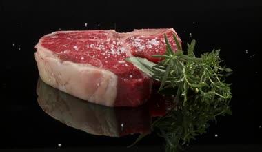 Sprinkling T-bone steak — Stock Video