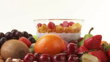 Fresh fruit and bowl of cornflakes — Stock Video