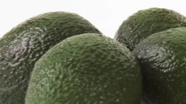 Four avocados on white background — Stockvideo