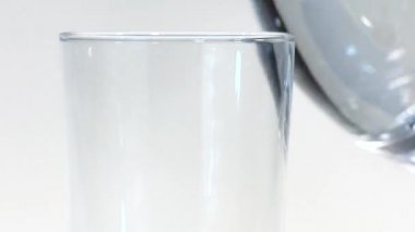 Pouring water into a glass — Stock Video
