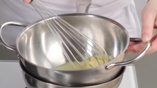 Eggs being beaten in a bain marie — Vidéo