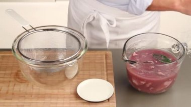 Veal in a red wine marinade being drained — Stock Video
