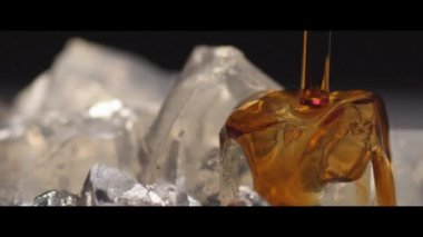 Herb liqueur being poured over ice — Stock Video