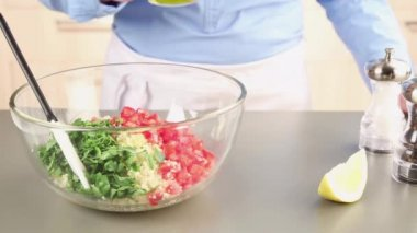 Ingredients for tabbouleh being seasoned — Stock Video
