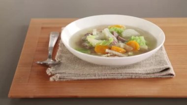 Pot-au-feu with spoon and napkin — Stock Video