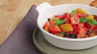 Ratatouille in a white bowl — Stock Video