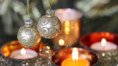 Christmas baubles and tealights — Stock Video