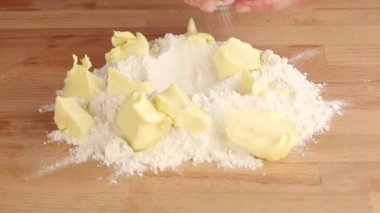 Butter on a pile of flour being sprinkled with salt — Stock Video