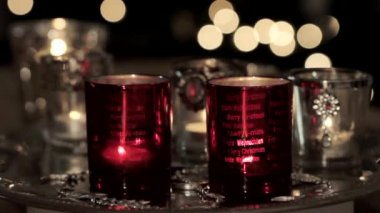 Tealights with Christmas decorations — Stock Video