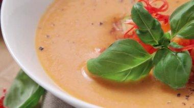 Gazpacho garnished with basil — Stock Video