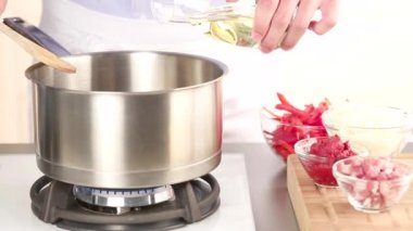 Oil heated in a pot — Stock Video