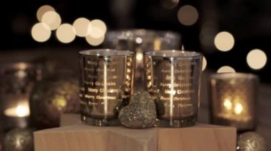 Decorations, tealights and a wooden star — Stock Video