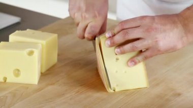 Rind being cut off a piece of cheese being — Stock Video