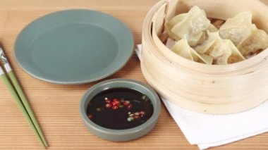 Dim sum in a bamboo basket and soy with — Stock Video