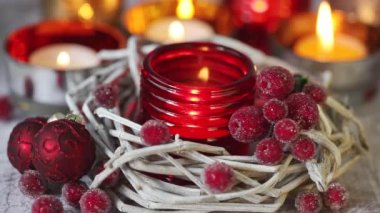 Tealight in a red glass holder — Stock Video