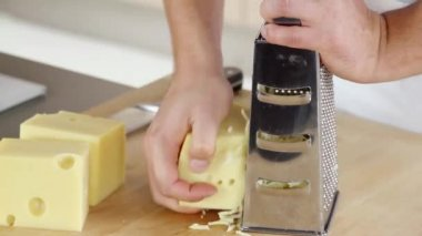 Coarsely grating cheese — Stock Video