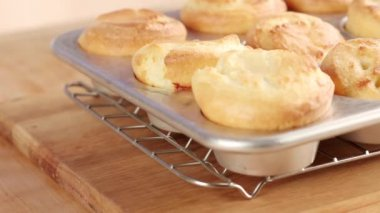 Puddings in a muffin tin — Stock Video
