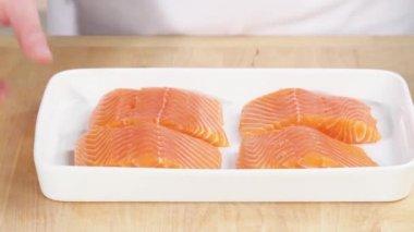 Marinade being spread onto salmon — Stock Video