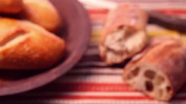 Ciabatta next to a breadbasket with a bread roll — Stock Video