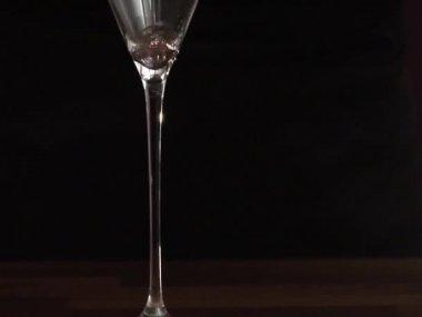 Straining Cosmopolitan into a glass — Stock Video
