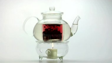 Glass teapot on warmer — Stock Video