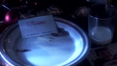 Plate with Santa's calling card and gifts — Stock Video